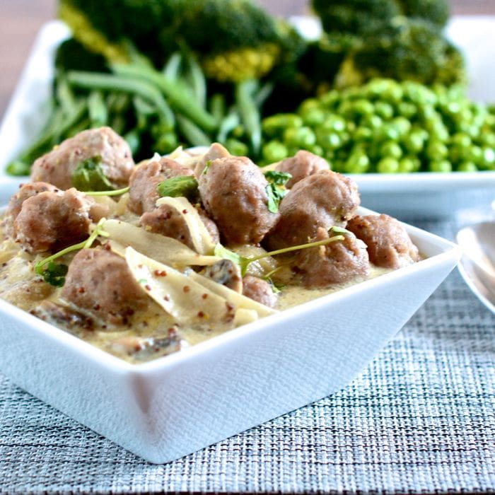 A deliciously different sausage recipe - Pork sausages and mushrooms cooked in wholegrain mustard, creme fraiche and cider. Perfect served with creamy mashed potatoes and lots of peas.