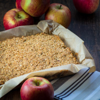 Apple crumble flapjacks - Golden flapjacks with a layer of juicy apple and raisins. Perfect on their own as a snack or smothered in hot homemade custard for a warming dessert.