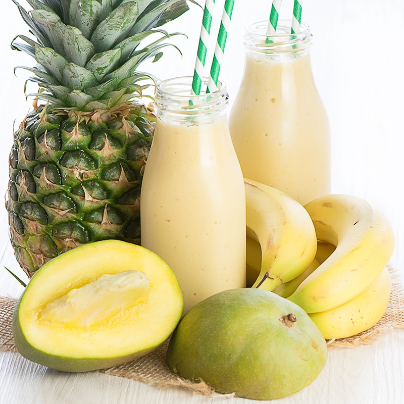 A delicious refreshing smoothie with coconut milk, banana, mango and pineapple.