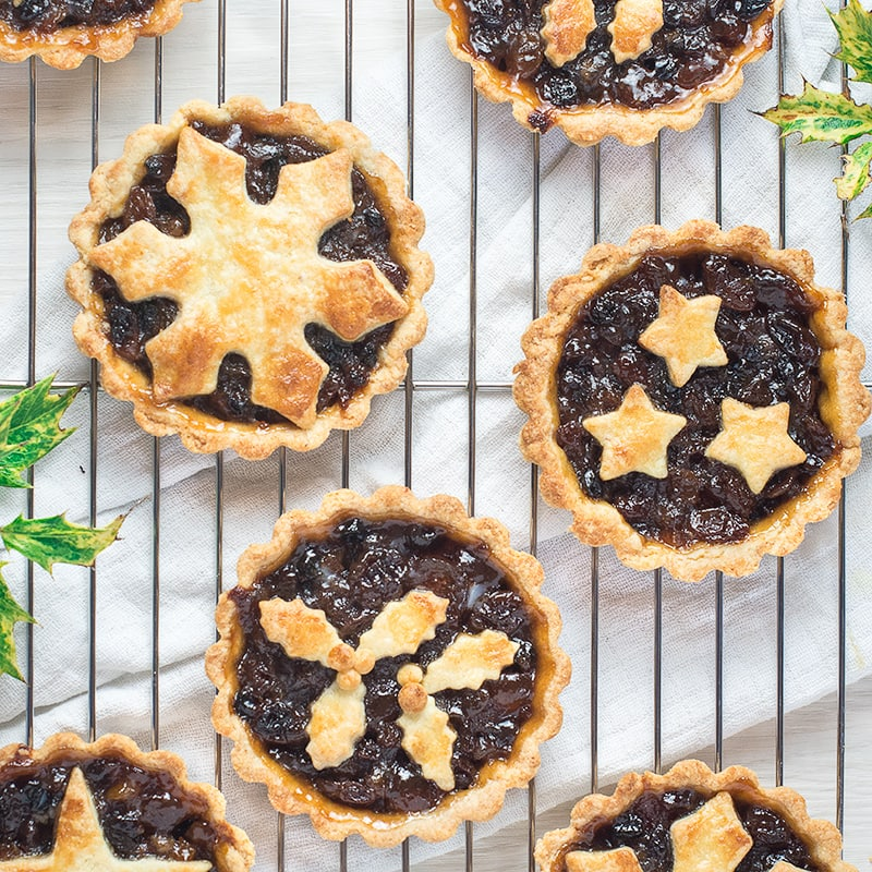 Make your Christmas extra special with these pretty mince pies decorated with stars, holly and snowflakes. Perfect for festive parties or as a treat with a cup of tea on a chilly evening.
