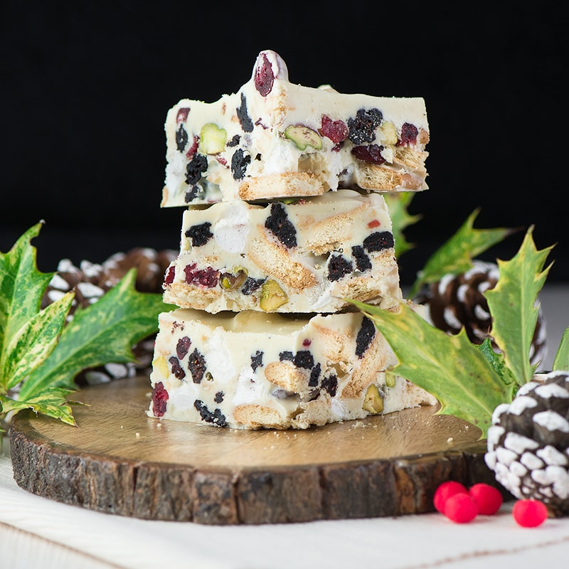 A festive version of my easy-to-make rocky road recipe with white chocolate, biscuits, marshmallows, dried cranberries and pistachio nuts.