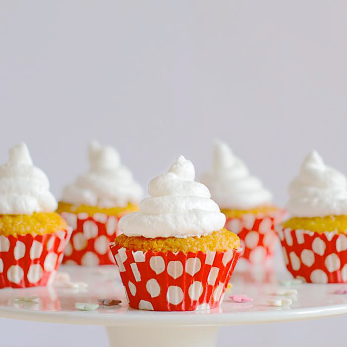 Queen of puddings cupcakes - Vanilla sponge with a hidden raspberry jam and custard centre and topped with an italian meringue frosting.