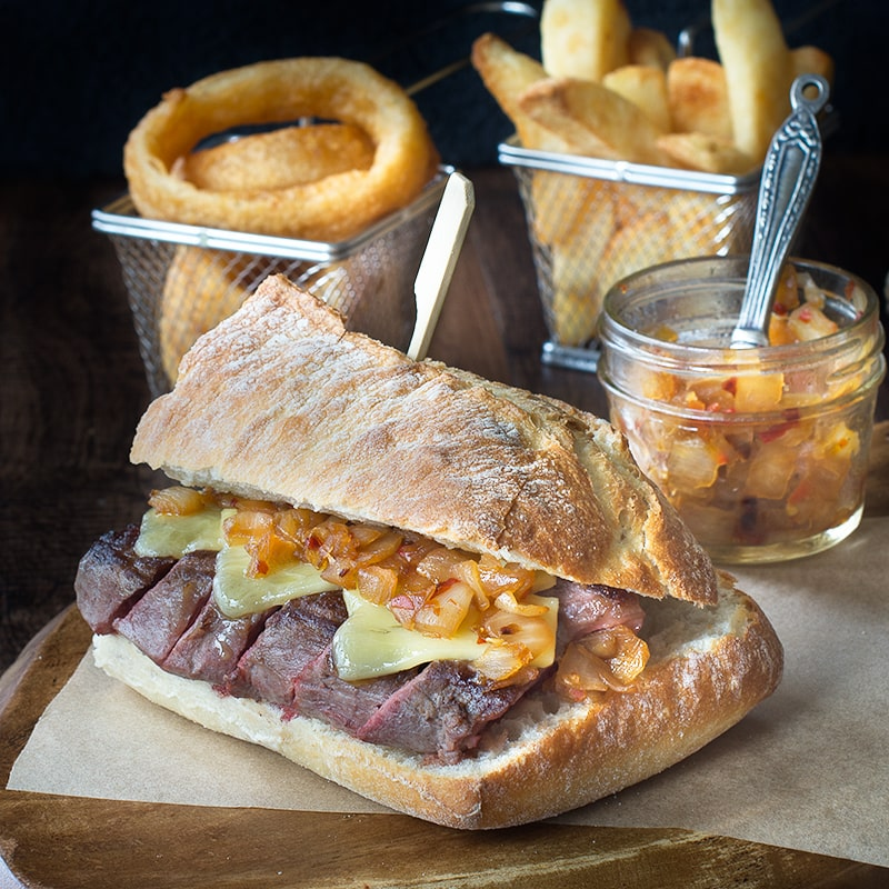 Juicy sirloin steak topped with cheddar cheese and an easy homemade spicy onion relish, served in crusty ciabatta.