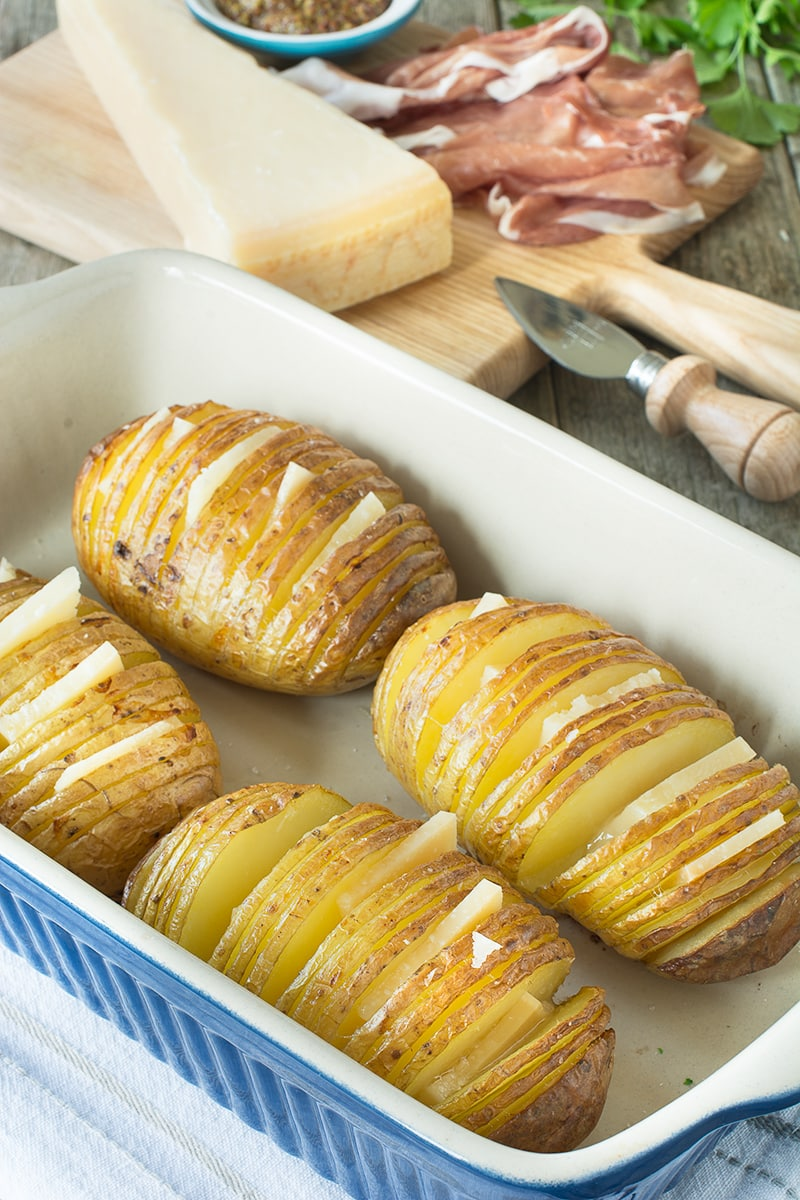 Hasselback potatoes stuffed with Grana Padano cheese, Prosciutto di San Daniele and wholegrain mustard.