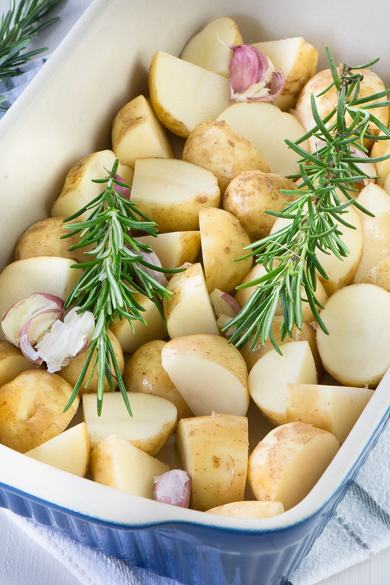 Roasting the potatoes for this potato salad with garlic and herbs means it's full of flavour, especially when you add homemade mayonnaise too. It's perfect for a summer barbecue or picnic.