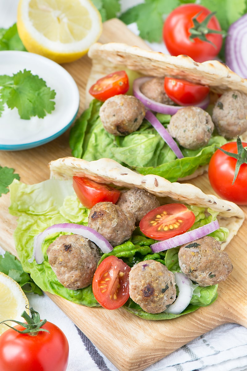 These easy lamb koftas flavoured with spices, mint and lemon zest are perfect for a summer barbecue, served in a flat bread with salad and yogurt.