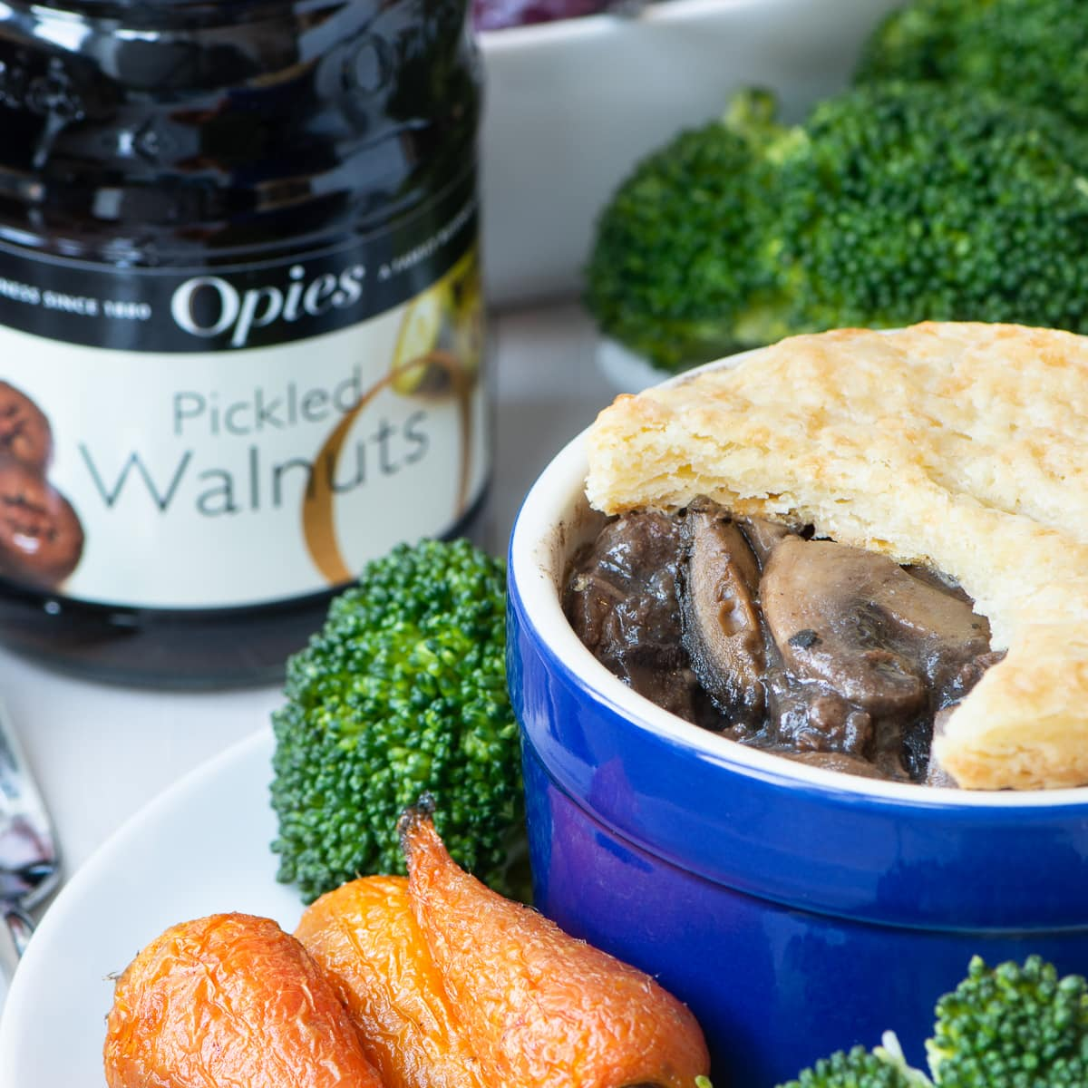 Beef and Pickled Walnut Pie – A rich and delicious beef, mushroom and pickled walnut pie topped with a homemade cheesy flaky pastry crust.