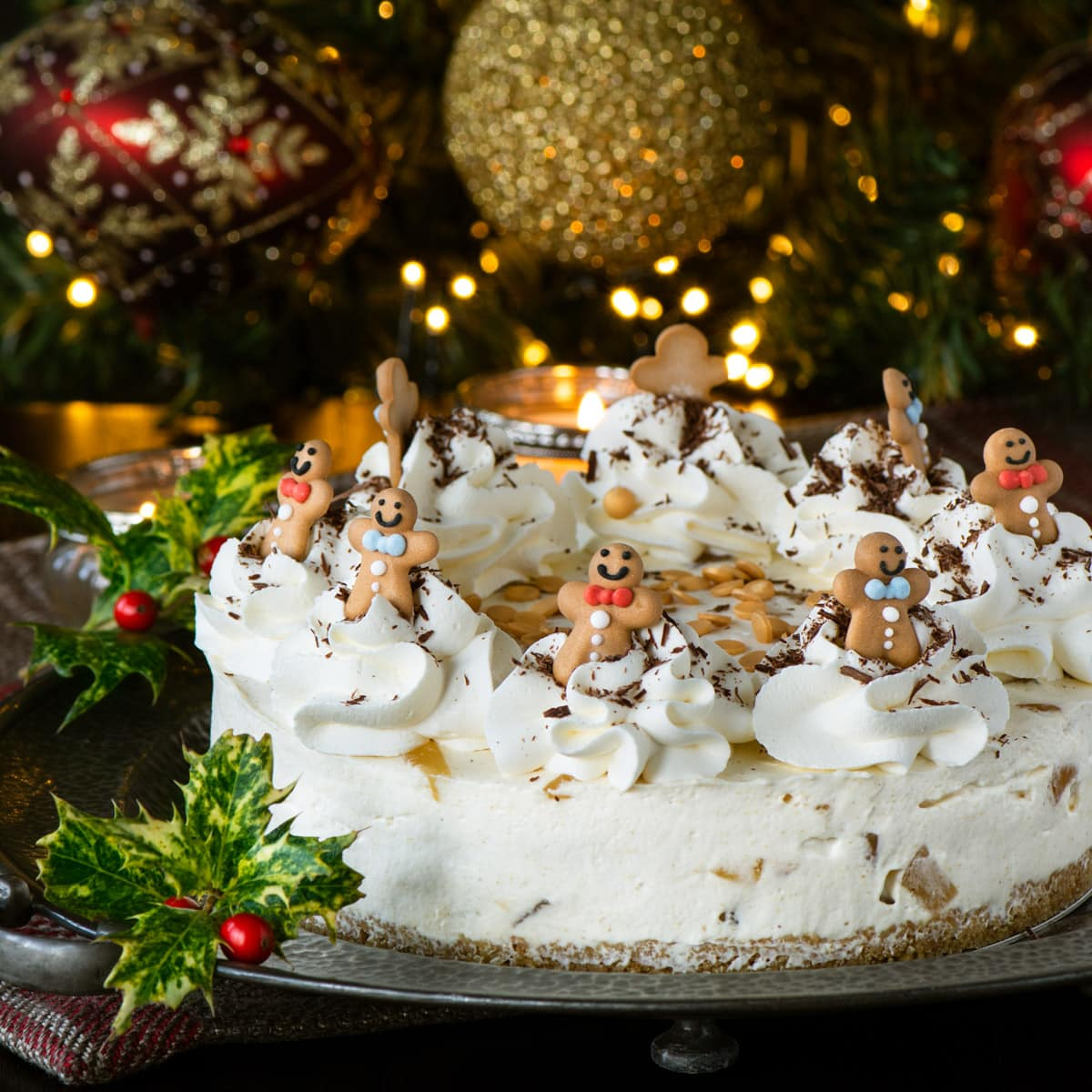 No-Bake Ginger Cheesecake - A crunchy biscuit base with a smooth ginger cheesecake filling and plenty of chopped stem ginger running through it, topped with swirls of whipped cream and grated dark chocolate.