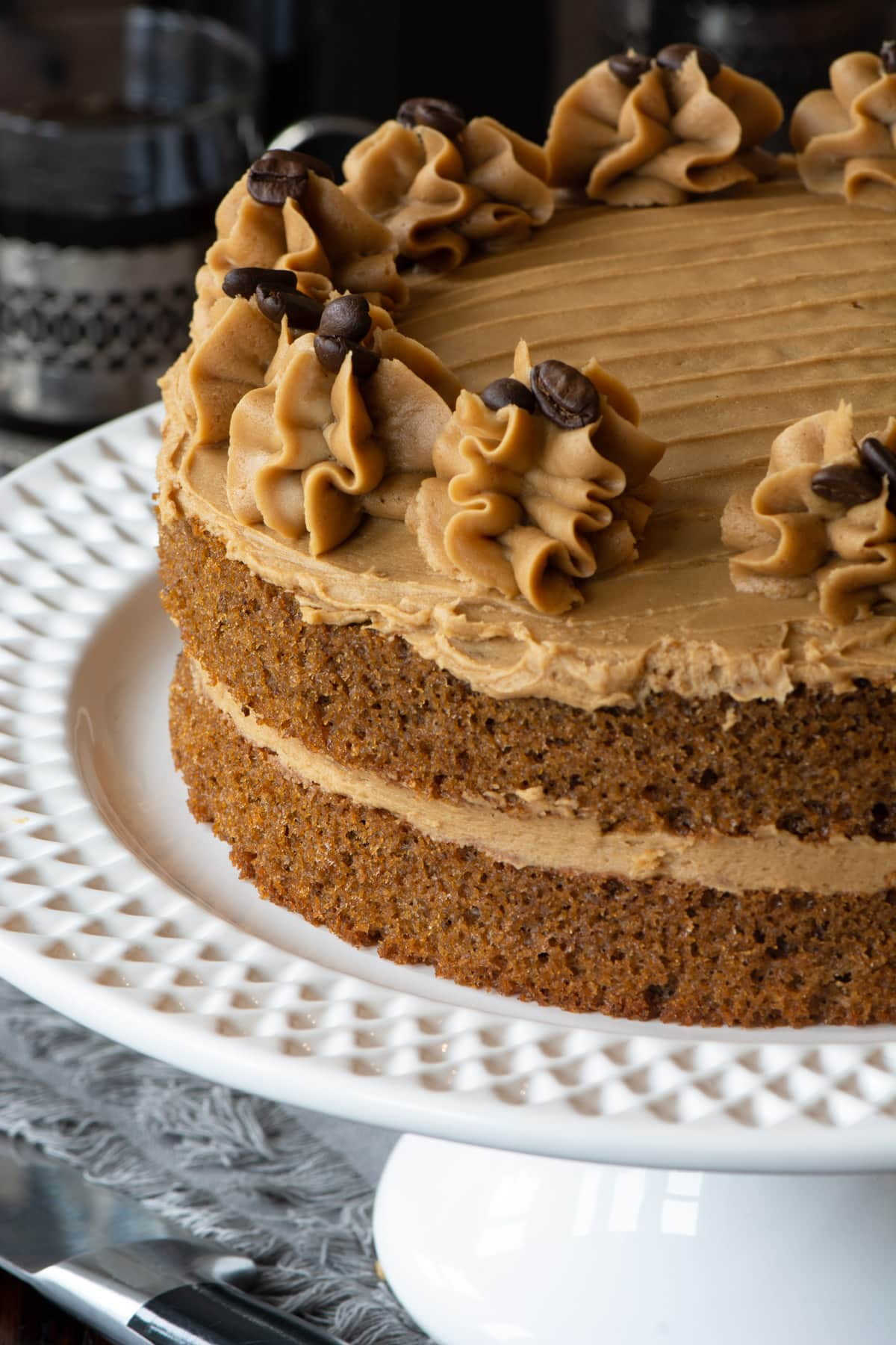 Easy Coffee Cake - A delicious all-in-one coffee sponge topped with smooth coffee buttercream. Simple to make and packed full of flavour. PLUS - How to make this cake in any size of round, square or rectangular tin.