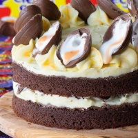 Creme Egg Cake. A chocolate sponge cake with white chocolate buttercream, topped with Creme Eggs.