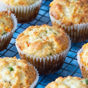 Savoury muffins on a cooling rack.