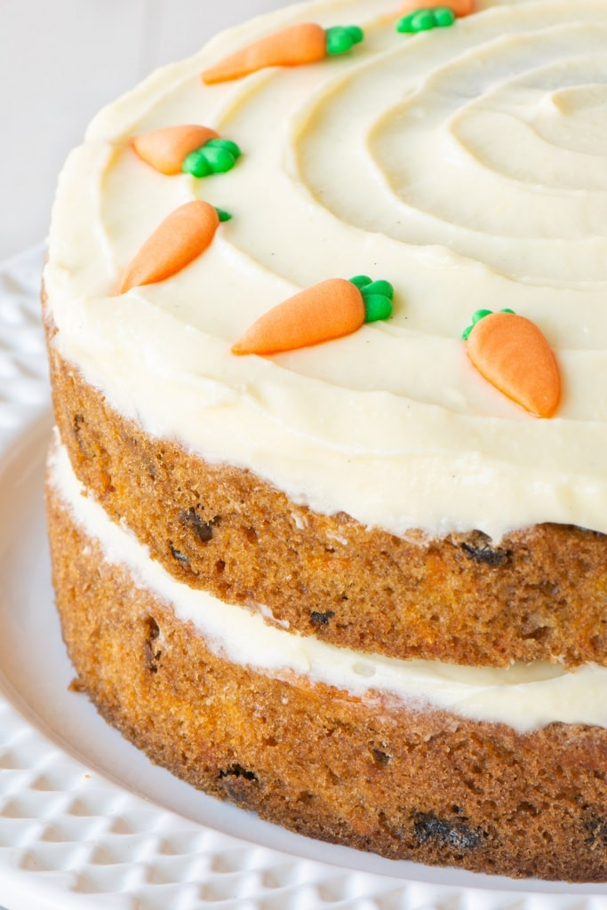 A close of of a carrot cake layer cake.