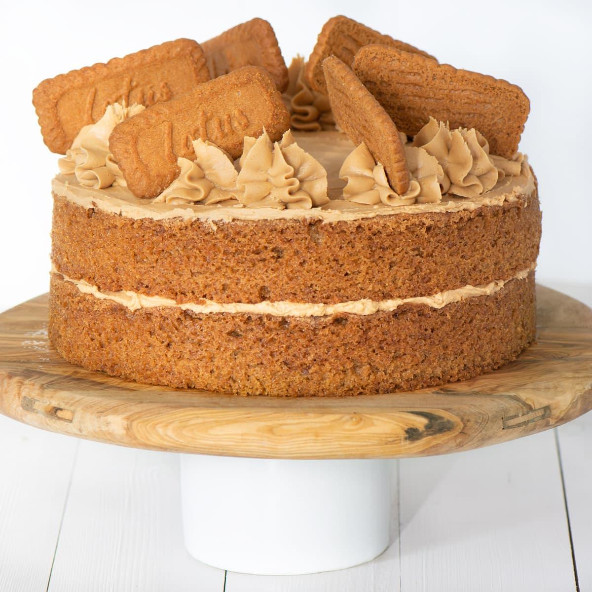 Biscoff cake on a cake stand.