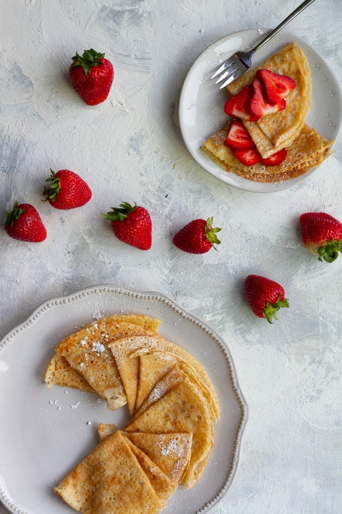 Vegan crepes served with strawberries.