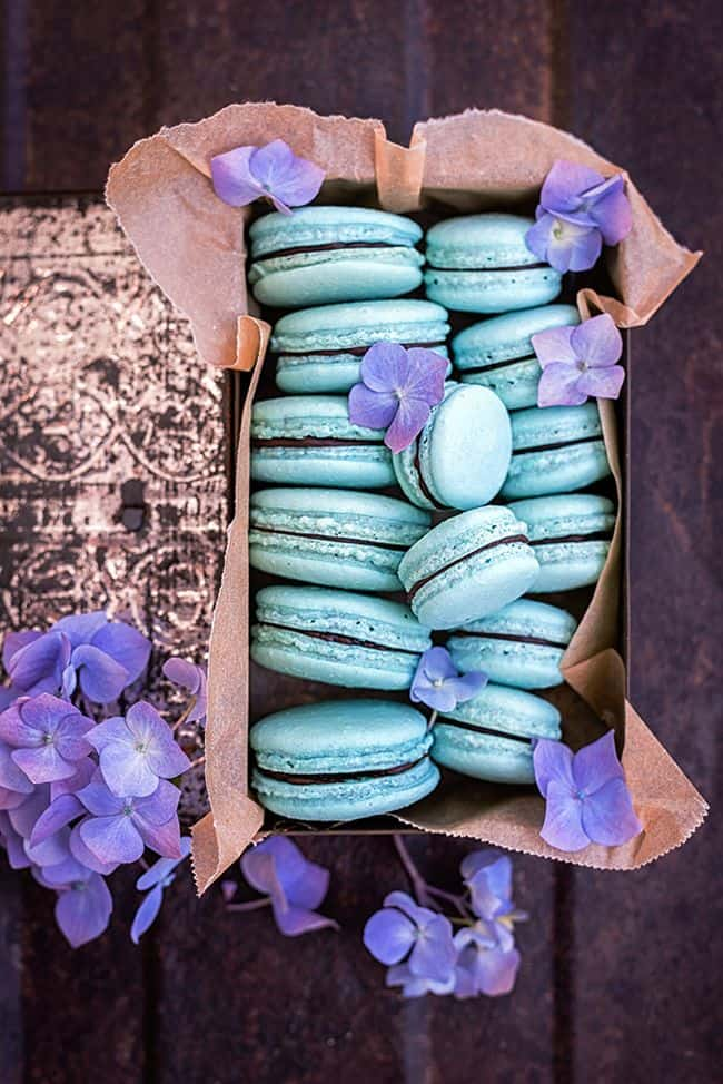 Blue macarons filled with ganache.