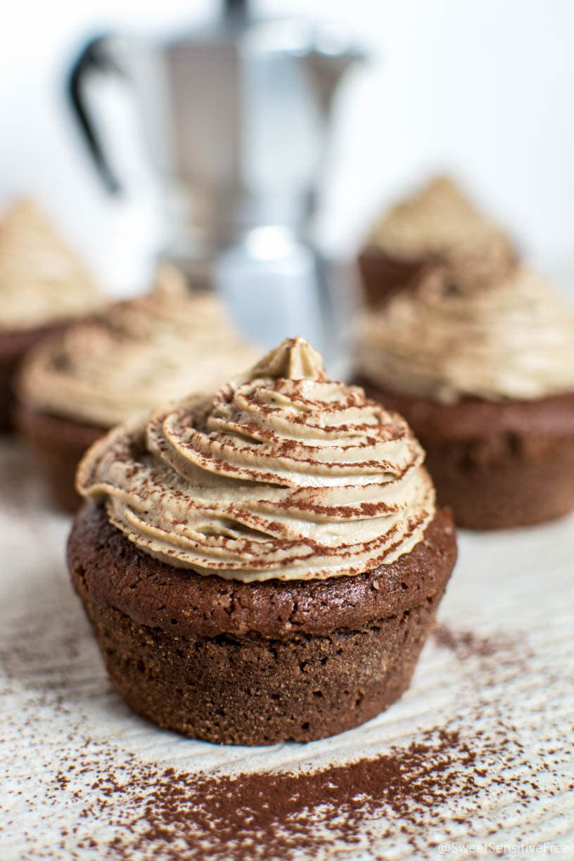 A cocoa cupcake topped with coffee frosting.