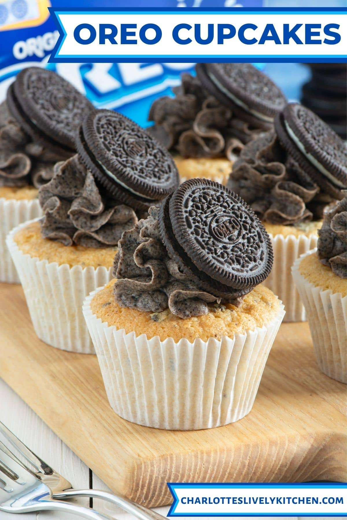 Close up of decorated oreo cupcakes on a wooden board.