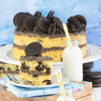 A slice of Oreo sponge cake served with milk.