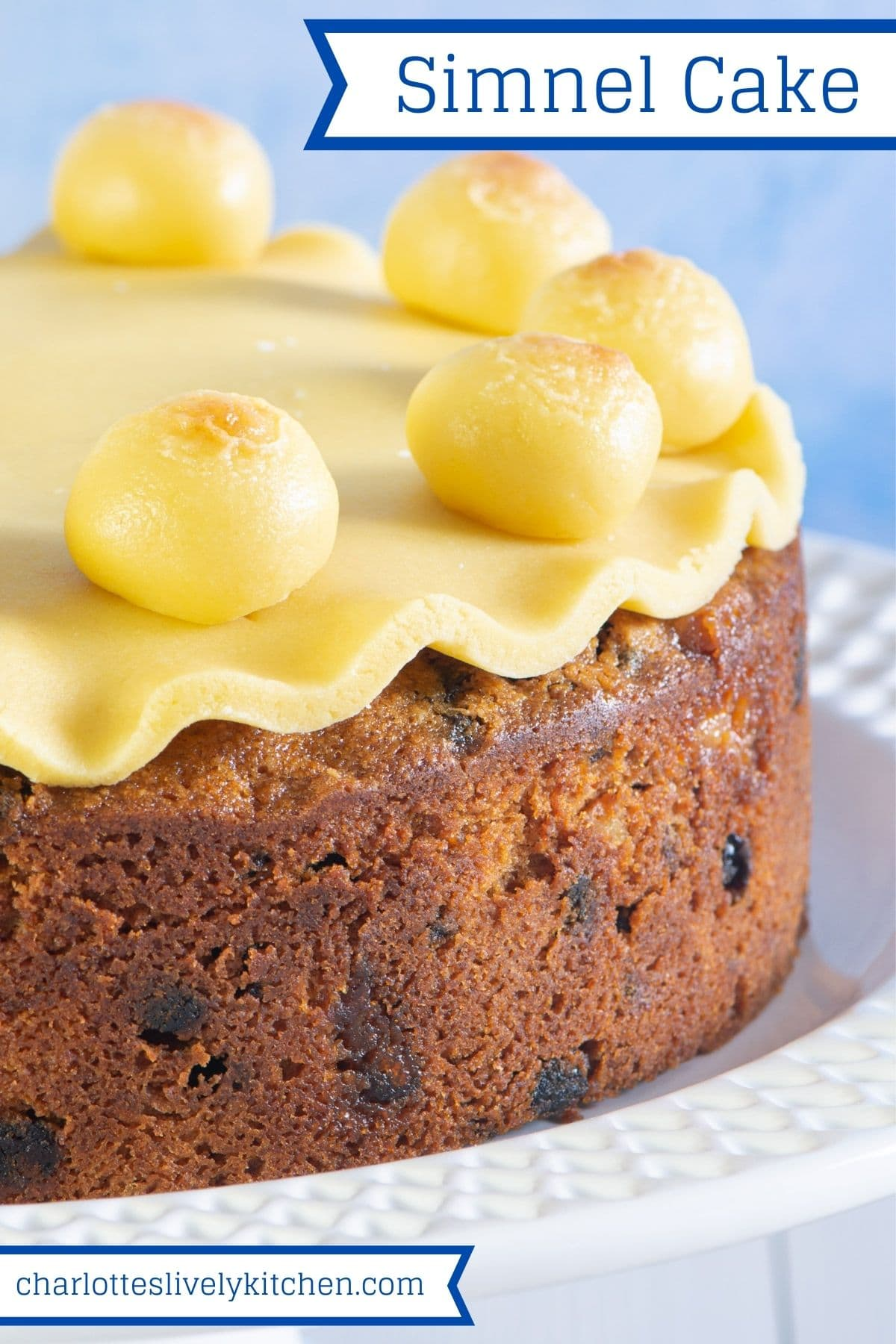 Close up of simnel cake with marzipan decorations with text overlay: Simnel Cake.