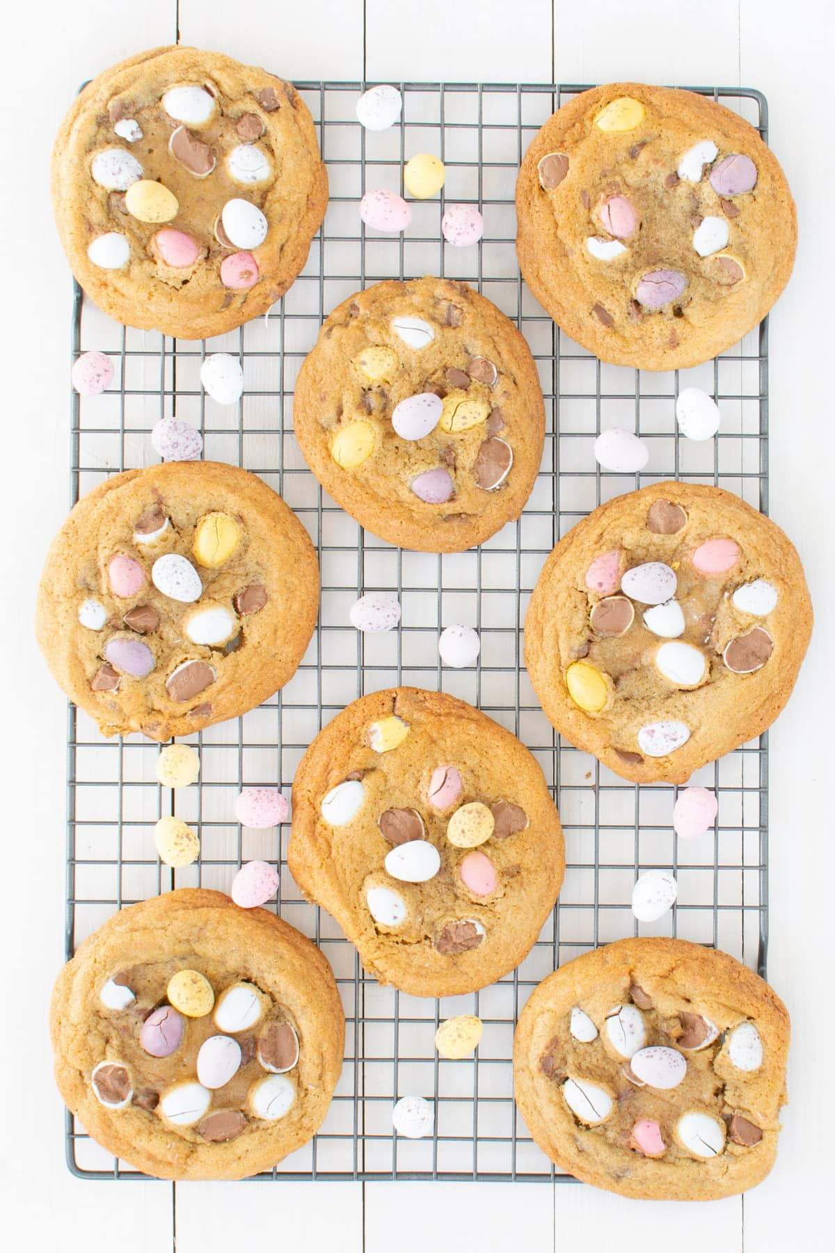 Mini egg cookies on a cooking rack.